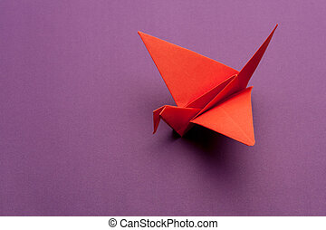 origami paper crane - red origami paper crane on purple ...