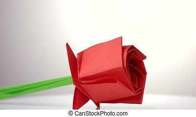Red origami tulip flower. Traditional spring flower made...