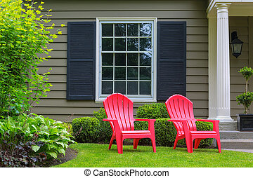 Red Outdoor Chairs on Front Yard Lawn