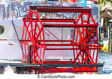 Red Paddle on Old Paddle Wheel Boat