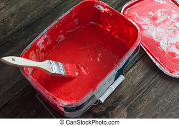 Red paint in a bucket
