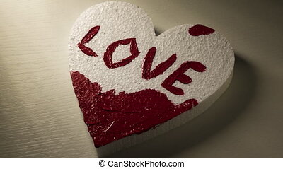 Red paint Love and Love you inscriptions being made on the hearts, two 4K stop motion time lapse animations in one, ProRes