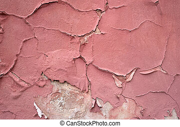 Red paint peeling off from a building wall texture