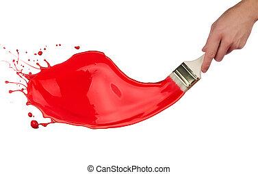 Red paint splashing out of brush. Isolated on white background