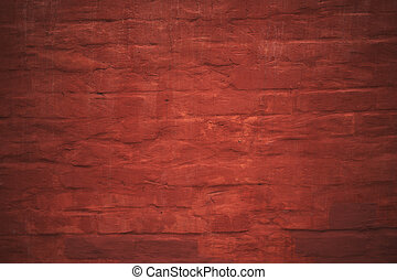 red painted brick wall with plaster