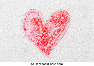 Red painted heart on a concrete wall