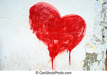 Red painted heart on blue cracked wall