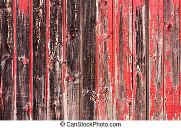 Red Painted Wood Paneling - An old worn barn or wooden fence...