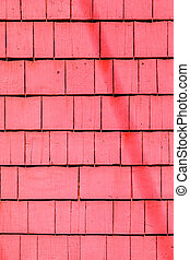 red painted wooden shingles at the roof