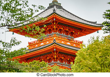 Red painted wooden temple in Kyoto