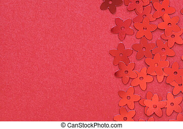 Red palettes in the form of flowers on a red background.