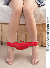 red panties - Close-up on beautiful woman's leg with red...
