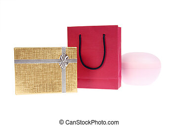 red paper bag and gold gift box with bow