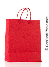 Red paper bag over white background.