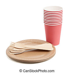 red paper cups and wooden fork, empty round brown disposable plate made from recycled materials