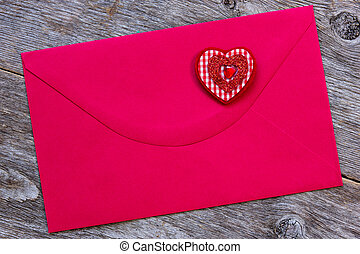 Red paper envelope with decorative heart
