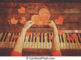 Red paper heart and music - Unrecognizable child holds red...