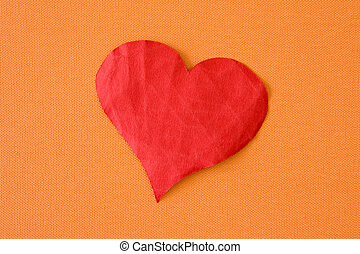 paper heart on the orange background