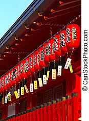 Red paper Japanese lanterns of Fushimi Inari-taisha shrine ...