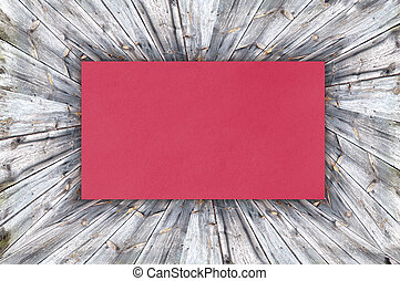 Red Paper on wood background or texture