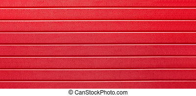 red pattern of horizontal lines, covering, background, abstraction, close-up. Plastic fence. web panorama banner with copy space.