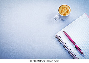 Red pen message pad ceramic coffee cup with cappuccino office concept
