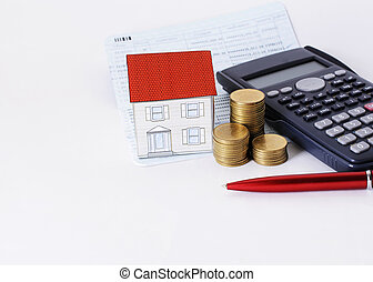 Red pen with coins stack and paper house and calculator on saving book