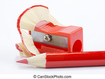 red pencil and pencil sharpener