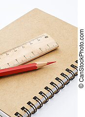 Red pencil and wooden ruler