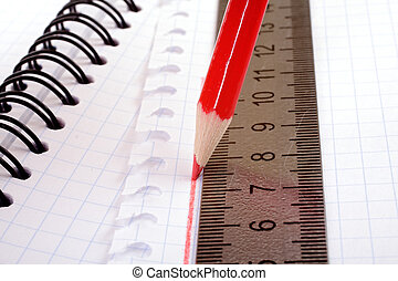 red pencil draws a flat line with a ruler