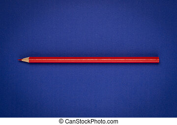 Red pencil on blue paper
