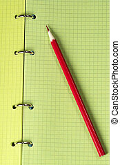 Red pencil over notebook