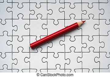 Red pencil on white jigsaw background