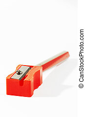 Red pencil sharpener with red/gold pencil and debris
