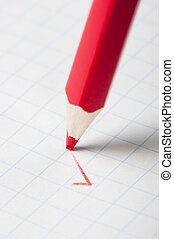 Red pencil writing a mark