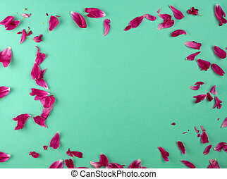 red peony petals on a green background, full frame, top view