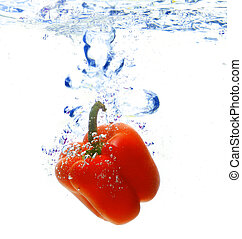 red pepper are dropped into water