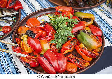 Red pepper grilled on a plate with parsley