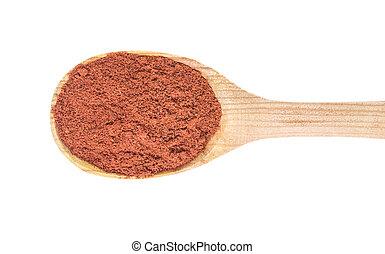 Red pepper in spoon