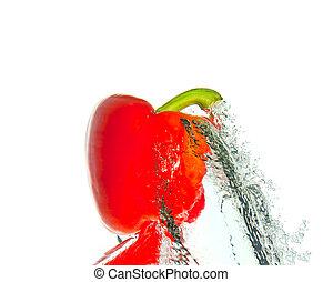 Red pepper in water splash