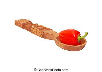 Red pepper in wooden spoon