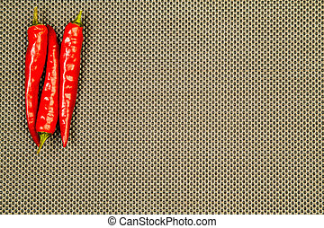Red pepper on a beige background