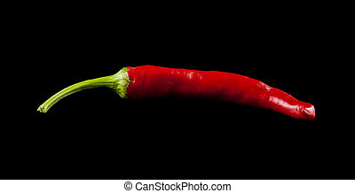 red pepper on a black background