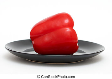 Red pepper on a black plate