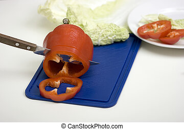 Red pepper on a chopping board