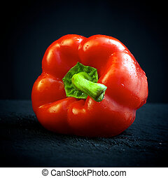Red pepper on black