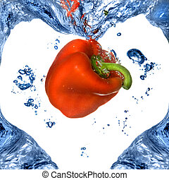 Red pepper with shape of heart from blue water isolated on white