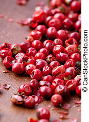 Red peppercorns - Close-up of red peppercorns on a wooden ...