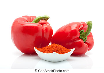 red peppers and paprika in a dish isolated on white background