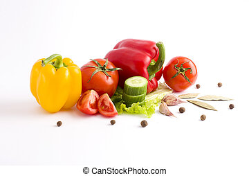 Red and yellow peppers on a white background. Tomato with peppers and cucumber on a white background.